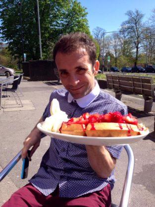 David enjoying his waffles