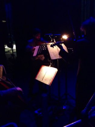 The musicians playing backstage
