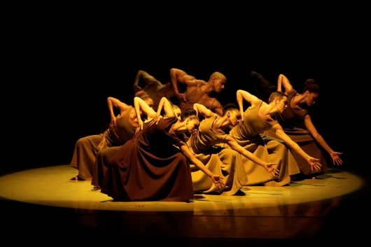 Alvin Ailey American Dance Theater in Alvin Ailey's Revelations. Photo by Pierre Wachholder